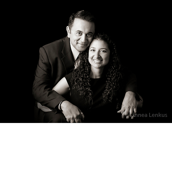 photography of a couple smiling and hugging