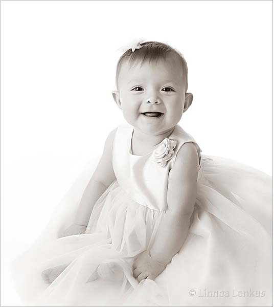 infant photography of girl in a white dress photographed in a Los Angeles portrait studio