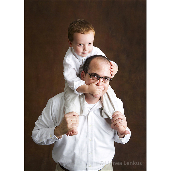 family photography of child on father's shoulders