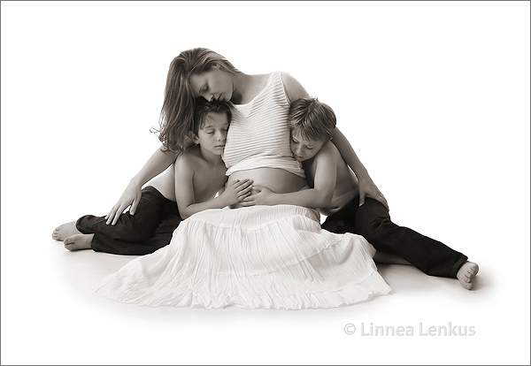 a pregnant mother and her two sons, maternity family portrait