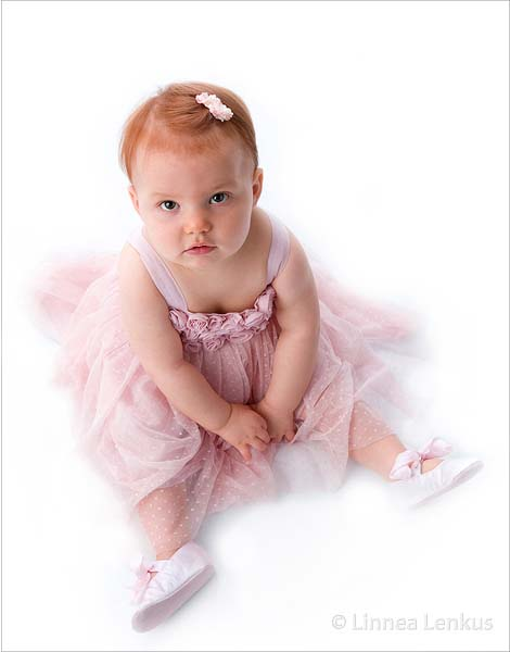 a baby girl in pink photographed in portrait photo studios Los Angeles